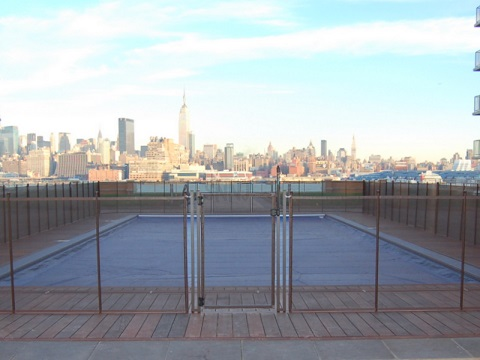 brown pool fencing skyline view