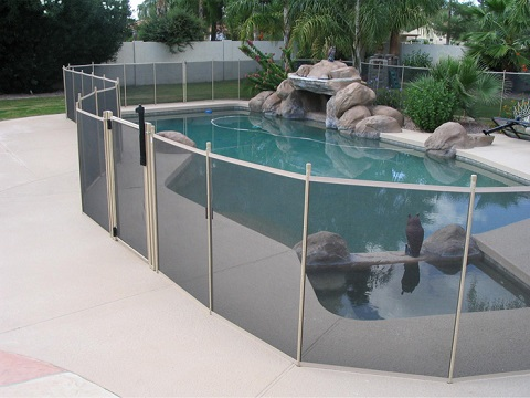 pool fencing with tan border, pole
