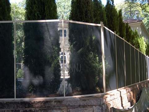 removable mesh pool fence in tan color