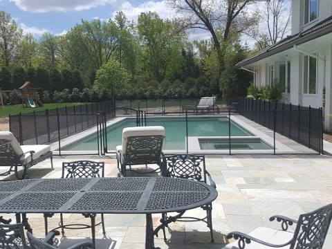 pool fence installed on dry, stone surface in North New Jersey