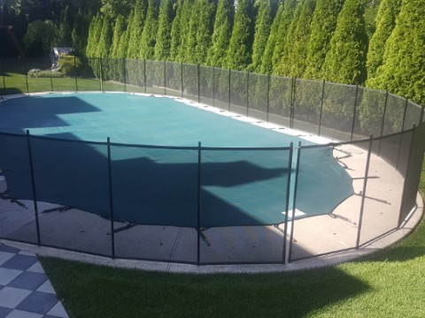4ft pool fence installed in an oval configuration