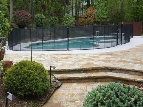 Pool Fence Installed on Stone Over Concrete Surface