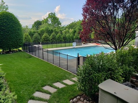 black mesh pool fence with self-closing pool gate