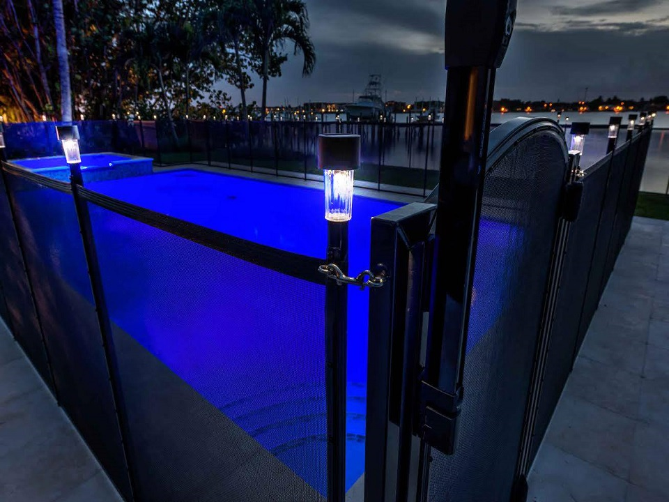 mesh pool fence with self-closing pool gate and solar lights installed by Life Saver of North New Jersey